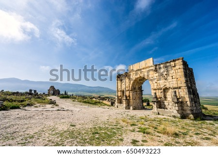 The Arch of Caracalla, the main entrance gate during the period of ancient roman empire in Volubilis in Morocco  #650493223