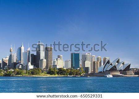 Sydney Australia view from ferry to royal botanic garden, City CBD and downtown houses on a sunny winter day.