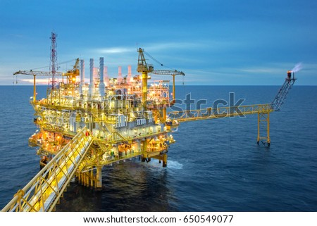 Industrial Offshore oil and gas rig platform with beautiful sky in the gulf of Thailand. #650549077