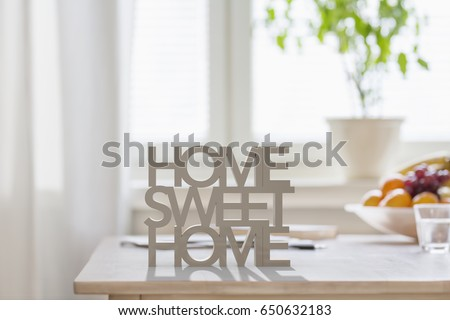Table top with 3D letters making the words home sweet home Royalty-Free Stock Photo #650632183