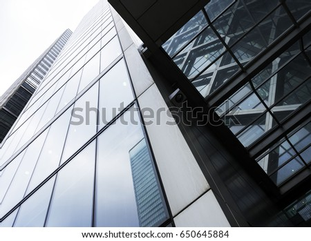 modern high rise buildings with reflections of sky and clouds #650645884