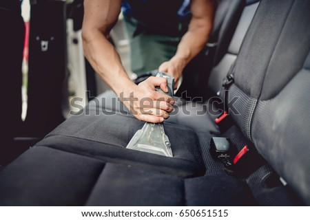 Close up details of car detailing - Cleaning and vacuuming car interior  Royalty-Free Stock Photo #650651515