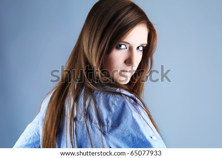 Portrait of an attractive  young woman. Studio shot. #65077933