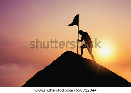 business, success, leadership, achievement and people concept - silhouette of businessman with flag on mountain top over sky and sun light background Royalty-Free Stock Photo #650912044