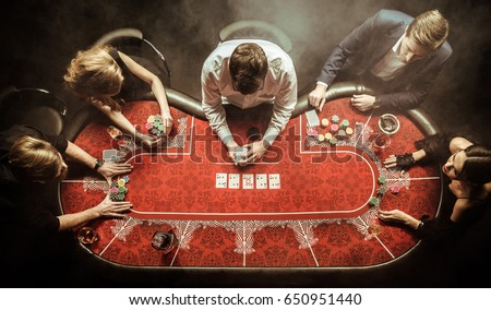 top view of men and women playing poker in casino Royalty-Free Stock Photo #650951440
