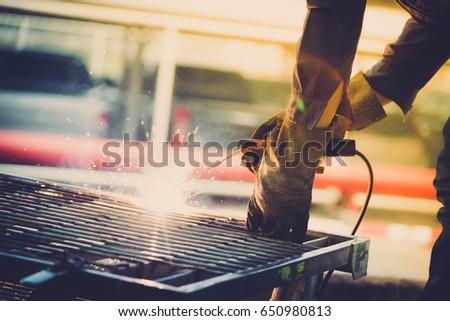 Men are welding damaged roll pallets. #650980813