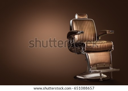 Stylish Vintage Barber Chair Isolated On Brown Background. Barbershop Theme #651088657