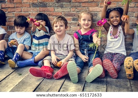 Group of kindergarten kids little farmers learning gardening #651172633