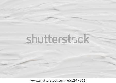 Cosmetics. Cream white background texture. #651247861
