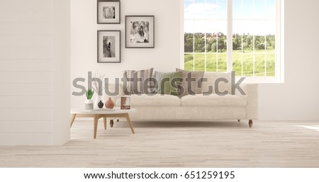 White room with sofa and green landscape in window. Scandinavian interior design. 3D illustration #651259195
