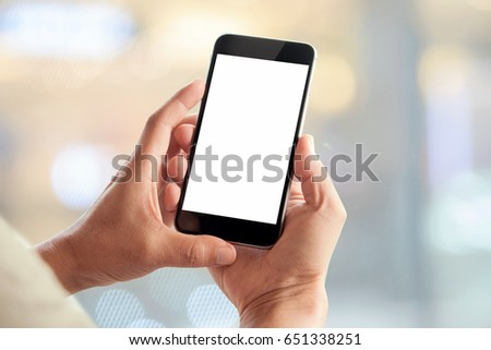 Man using smartphone on blur background. Blank screen smartphone for Graphic display montage. #651338251