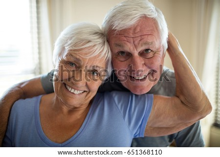 Portrait of senior couple embracing each other in the bedroom at home #651368110