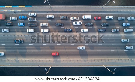Aerial top view of bridge road automobile traffic of many cars, transportation concept  Royalty-Free Stock Photo #651386824