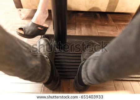 Men's legs under the table in the restaurant #651403933
