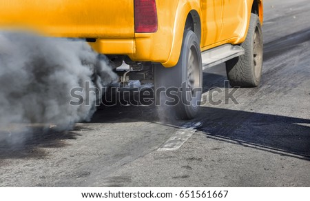 Air pollution from vehicle exhaust pipe on road #651561667