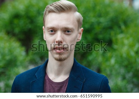 Portrait of an elegant man in the city #651590995