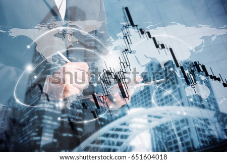 double exposure of businessman using tablet with blur city night and stockgraph. #651604018