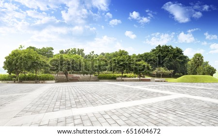 Empty street at the nice and comfortable garden background with nice blue sky Royalty-Free Stock Photo #651604672