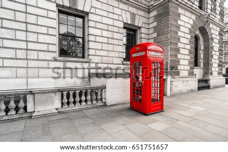 Vintage style image of typical red telephone booth in London
