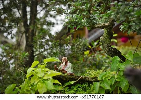 Chua Phap Bao buddhist temple with little bonsai tree in yard. #651770167
