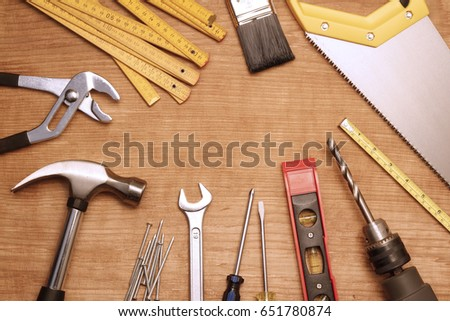 Assorted work tools on wood #651780874
