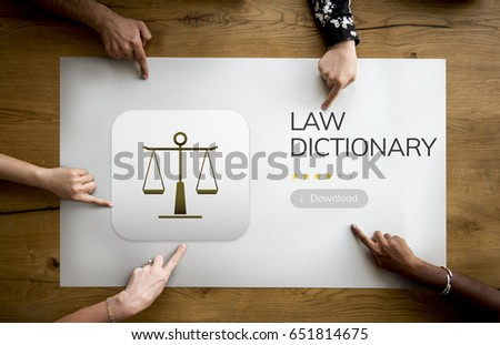 Diverse Hands point on a law concept on wooden table #651814675