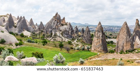 A geological formation consisting of volcanic tuff with cave dwelling. Cave monastery in Goreme Open Air Museum. Cappadocia in Central Anatolia is a UNESCO World Heritage Site since 1985, Turkey. Royalty-Free Stock Photo #651837463