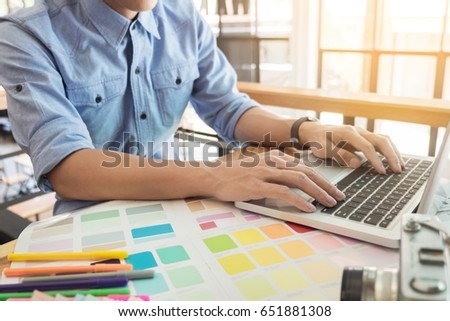Hands of female hipster modern graphic designer in office working with colour samples. Woman at workplace choosing colourful swatches, close-up. Creative people concept. #651881308