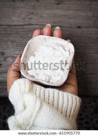 Salt with hand #651905770