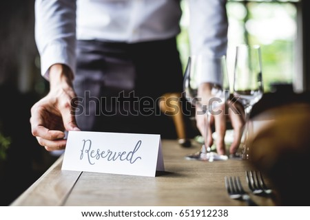 Elegant Restaurant Table Setting Service for Reception with Reserved Card Royalty-Free Stock Photo #651912238