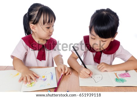 Asian Little Chinese girls drawing with color pencils in isolated white background #651939118