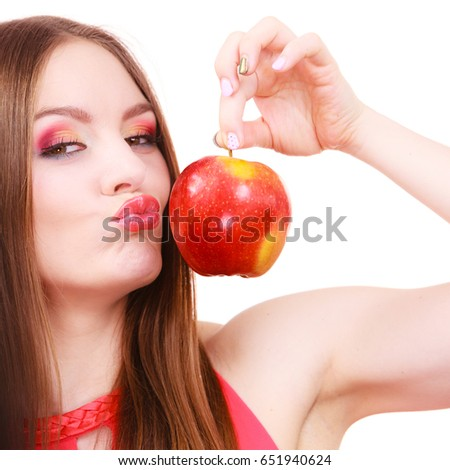 Woman young charming female long haired colorful make up holds big red apple fruit. Healthy eating, vegetarian food, dieting and people concept. #651940624