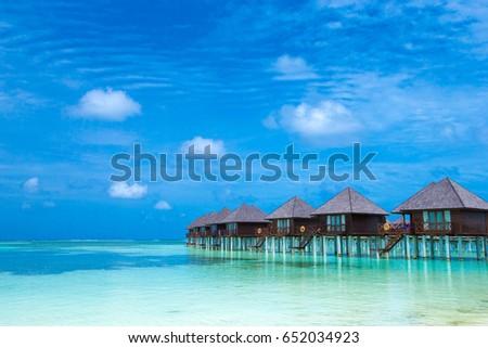 Beautiful tropical Maldives island with beach #652034923