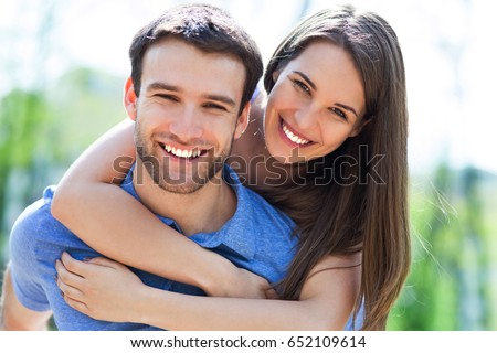 Young couple hugging  #652109614