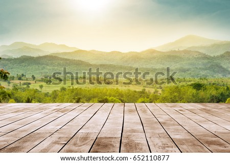 wooden table top with the mountain landscape