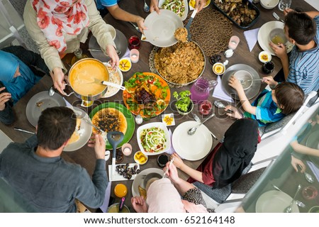 Top view of family and friends eating food on table #652164148