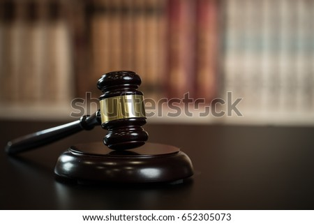 Judge hammer, scales of justice and law books in court #652305073