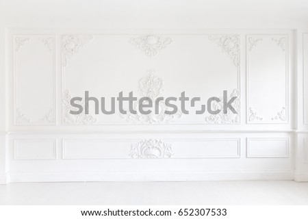 An elegant panel on a white wall made using stucco moldings Royalty-Free Stock Photo #652307533