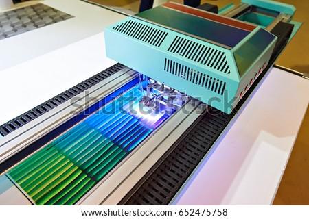 Large format UV coating printer in work