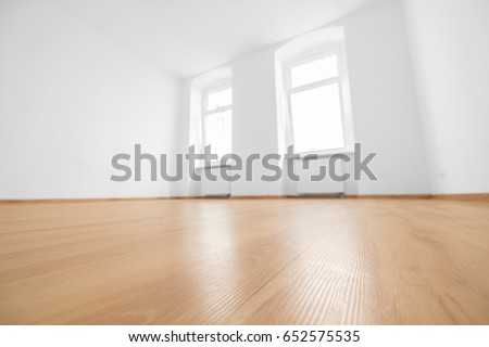 empty room, wooden floor in new apartment, blurred #652575535