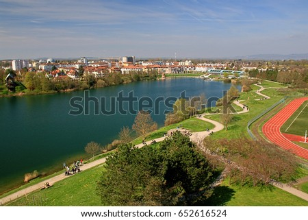 Aerial view of Freiburg Seepark which is a beautiful lake within the inofficial capital of Black Forest, Germany #652616524