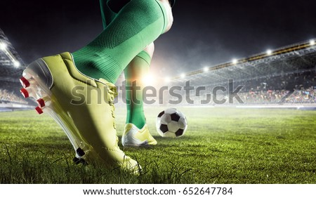 Soccer player in action. Mixed media Royalty-Free Stock Photo #652647784
