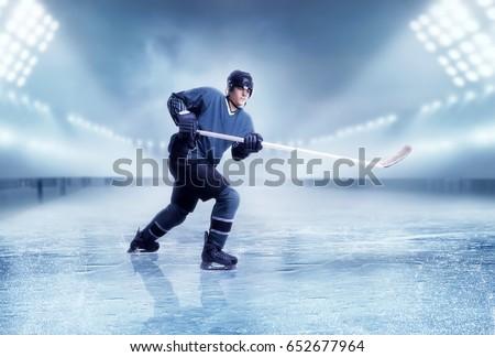 Professional ice hockey player shooting #652677964