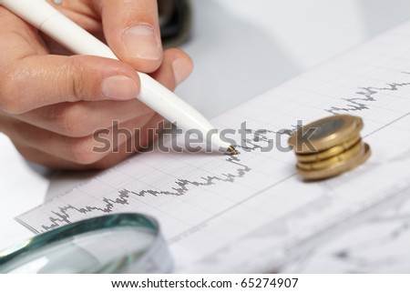 woman?s hand holding a pen #65274907