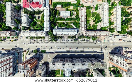 Aerial city view with crossroads and roads, houses, buildings, parks and parking lots, bridges. Helicopter drone shot. Wide Panoramic image. #652879012