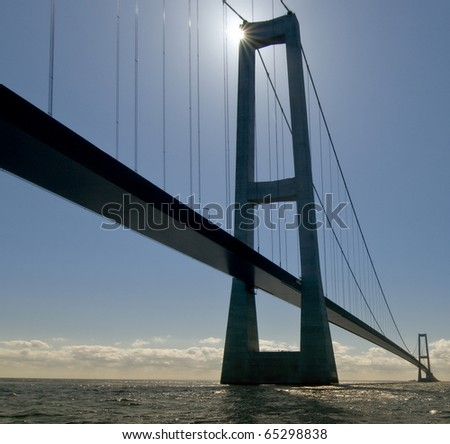 Suspension bridge on the sea with backlight #65298838