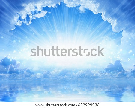Peaceful heavenly background - light from heaven, bright sunlight with reflection in sea Royalty-Free Stock Photo #652999936