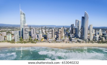 Aerial view looking towards Gold Coast Surfers Paradise cityscape and beach from over the ocean. #653040232