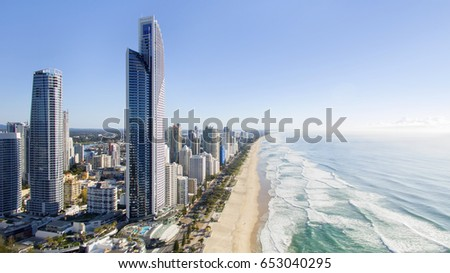 GOLD COAST, AUSTRALIA - MAY 23 2017: High aerial view of Surfers Paradise cityscape and coastline at sunrise. #653040295