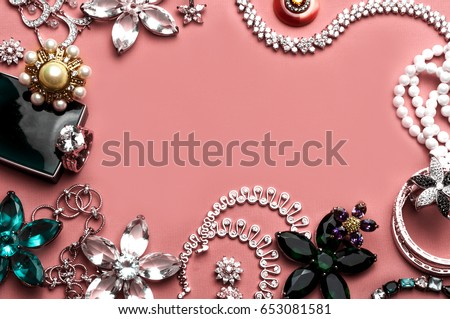 Beautiful jewelry with precious stones for women on a pink background #653081581